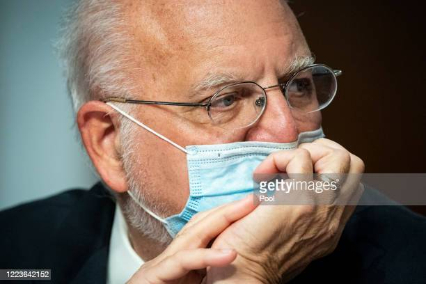 Robert Redfield, director of the Centers for Disease Control and Prevention , listens during a Senate Health, Education, Labor and Pensions Committee...
