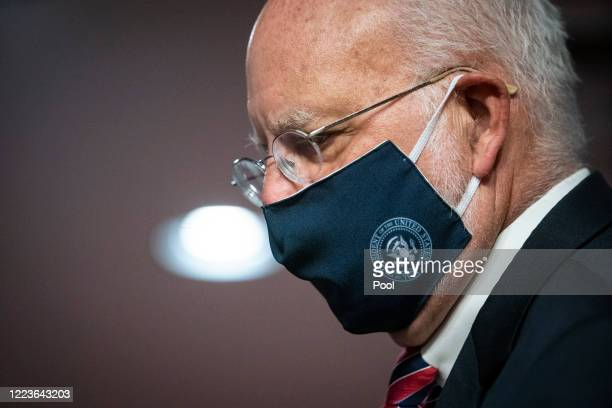 Robert Redfield, director of the Centers for Disease Control and Prevention , wears a face covering during a Senate Health, Education, Labor and...