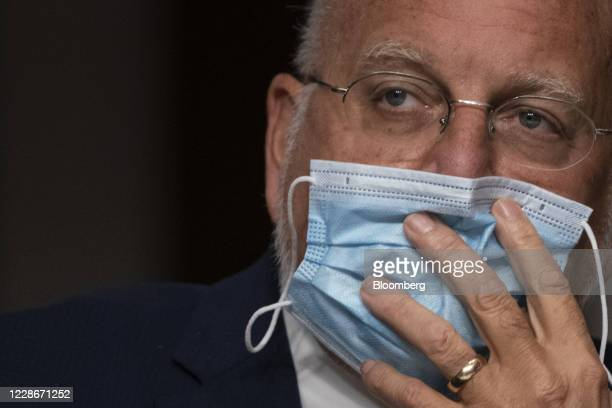 Robert Redfield, director of the Centers for Disease Control and Prevention , listens during a Senate Health Education Labor and Pensions Committee...