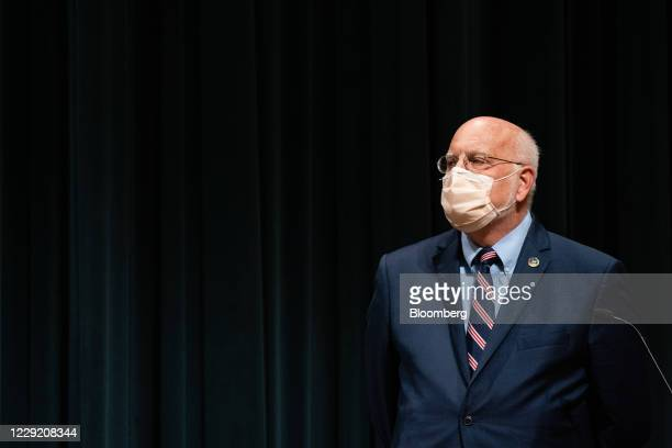 Robert Redfield, director of the Centers for Disease Control and Prevention , listens during a news conference at the CDC Roybal Campus in Atlanta,...