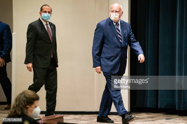 Robert Redfield, director of the Centers for Disease Control and Prevention , right, and Alex Azar, secretary of Health and Human Services , arrive...