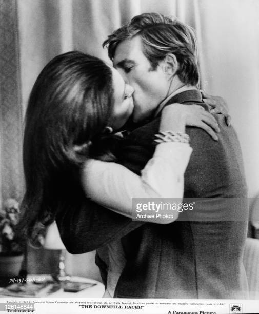 Robert Redford and Camilla Sparv passionately kissing in a scene from the film 'The Downhill Racer' 1969