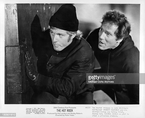 Robert Redford and George Segal plot to steal a priceless diamond in a scene from the film 'The Hot Rock', 1971.