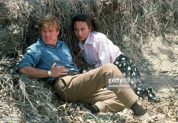 Robert Redford and Lena Olin lay low in a scene from the film 'Havana' 1990