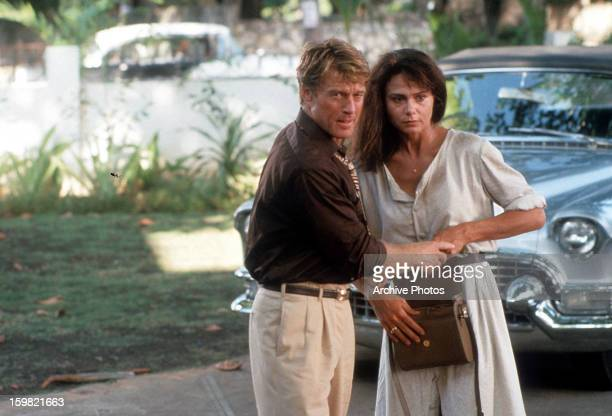 Robert Redford holds the hand of Lena Olin in a scene from the film 'Havana' 1990