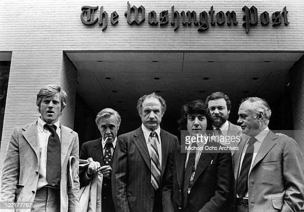 Robert Redford Jason Robards Jack Warden Dustin Hoffman director Alan J Pakula and Martin Balsam stand in front of the Washington Post building as...
