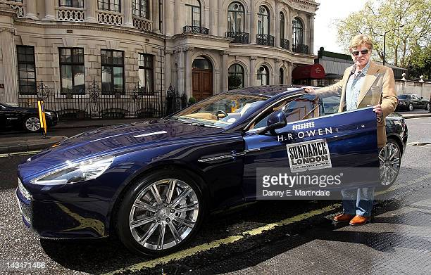 Robert Redford leaves The Four Seasons Hotel in an Aston Martin from Sundance London 2012 partner car sponsor HR Owen on his way to the Sundance...
