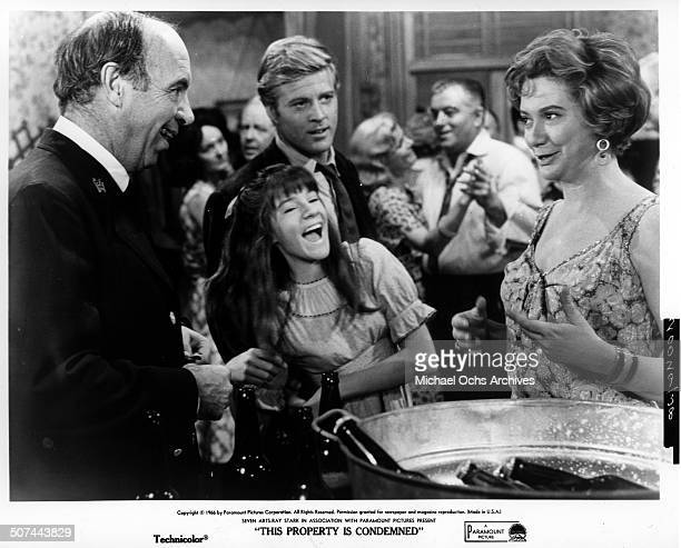 Robert Redford looks on as Mary Badham and Kate Reid laugh in a scene from the Paramount Pictures movie This Property Is Condemned circa 1966