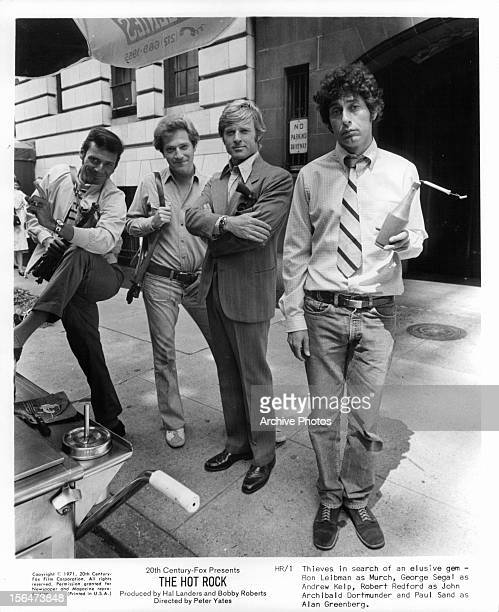 Robert Redford Paul Sand George Segal and Ron Leibman thieves in search of an elusive gem in a scene from the film 'The Hot Rock' 1972