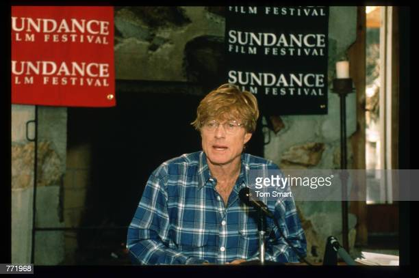 Robert Redford poses for a picture at a press conference for the film Four Weddings and a Funeral January 21 1994 in Salt Lake City Utah Redford is...
