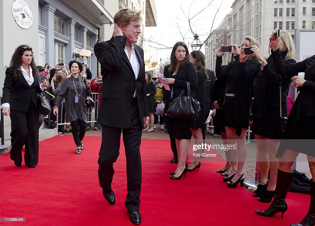 Robert Redford poses for photographers on the red carpet during the premiere of 'The Conspirator' presented by The American Film Company, Ford's Theatre and Roadside Attractions at Ford's Theatre on April 10, 2011 in Washington, DC.