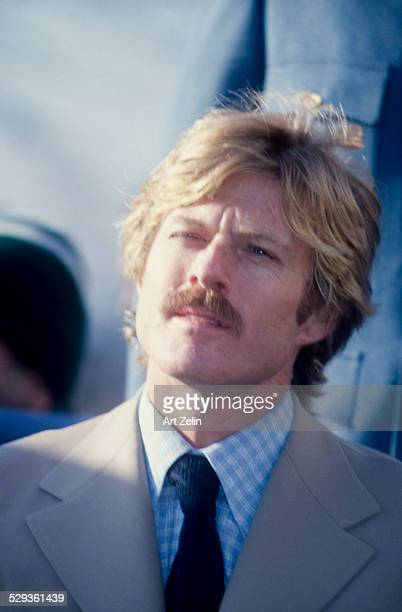 Robert Redford wearing a tan suit and checked shirt and blue tie circa 1970 New York