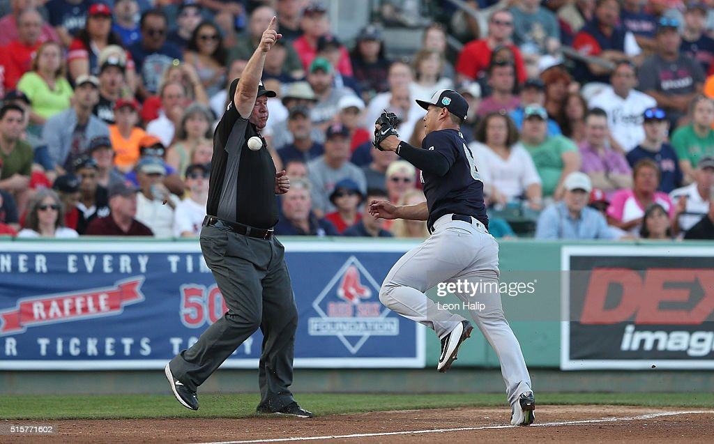 Robert Refsnyder #64 of the New York Yankees attempts to make the play on the ground ball down the third base line off the bat of Hanley Ramirez (Not in Photo) of the Boston Red Sox as third base umpire John Tumpane signals fair ball during the fourth inning of the Spring Training Game on March 15, 2016 at Jet Blue Park at Fenway South, Fort Myers, Florida. The Yankees defeated the Red Sox 6-3.