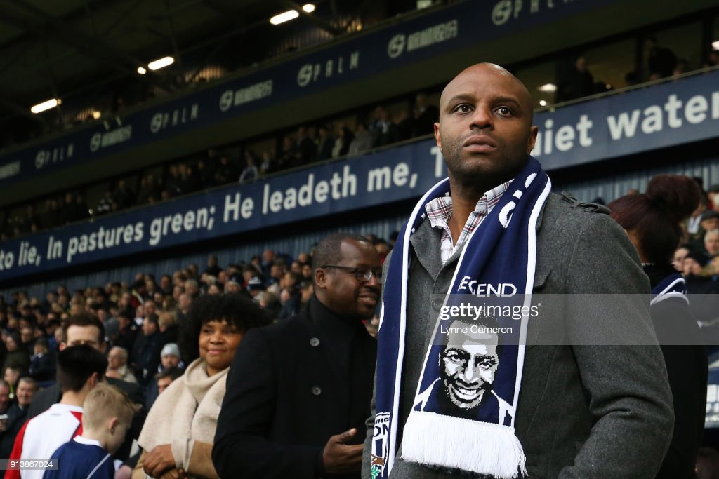 Robert Regis, son of Cyrille Regis pays tribute to his father during the Premier League match between West Bromwich Albion and Southampton at The Hawthorns on February 3, 2018 in West Bromwich, England.