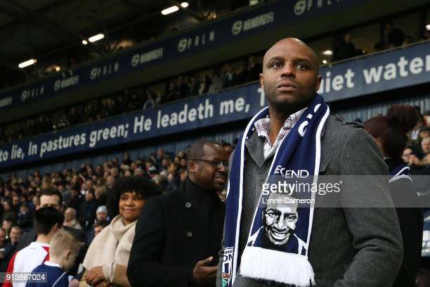 Robert Regis son of Cyrille Regis pays tribute to his father during the Premier League match between West Bromwich Albion and Southampton at The...
