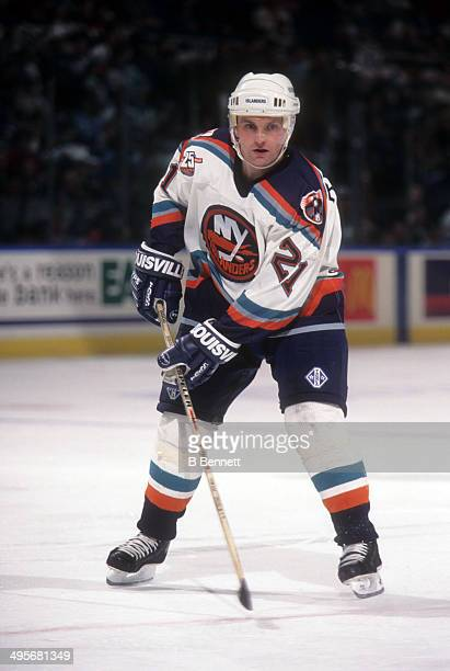 Robert Reichel of the New York Islanders skates on the ice during an NHL game in April, 1997 at the Nassau Coliseum in Uniondale, New York.