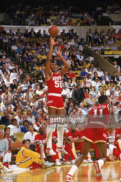 Robert Reid of the Houston Rockets makes a jump shot during a game in the198788 season NOTE TO USER User expressly acknowledges and agrees that by...