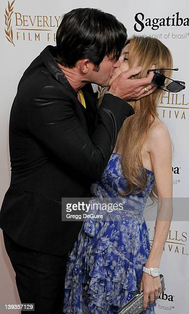 Robert Rey and Hayley Rey arrive at the opening night of the 16th Beverly Hills Film Festival at the Clarity Theater on April 14 2010 in Beverly...