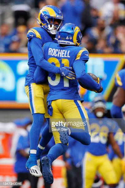 Robert Rochell and Donte' Deayon of the Los Angeles Rams celebrate Rochell's interception during the second half against the New York Giants at...