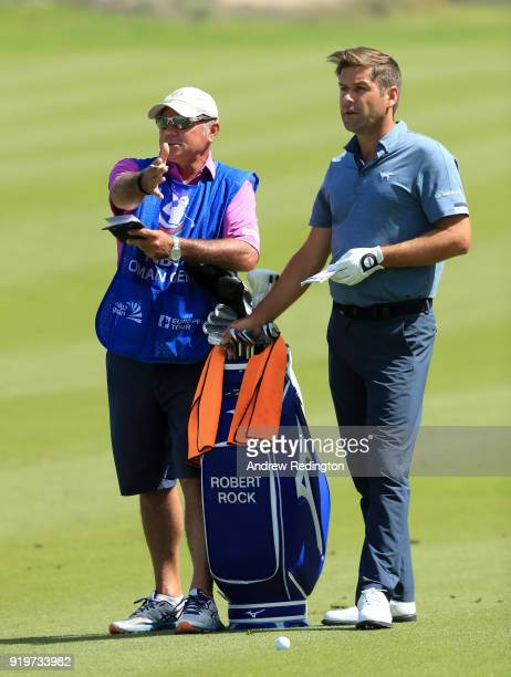 Robert Rock of England and his caddie Kyle Roadley during the final round of the NBO Oman Open at Al Mouj Golf on February 18 2018 in Muscat Oman