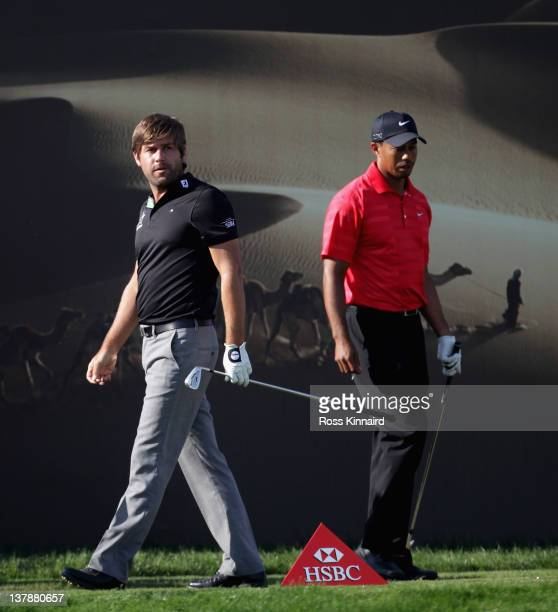 Robert Rock of England and Tiger Woods of the USA during the final round of Abu Dhabi HSBC Golf Championship at the Abu Dhabi HSBC Golf Championship...