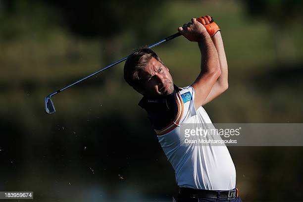 Robert Rock of England hit his second shot on the 18th hole during the first round of the Portugal Masters at Oceanico Victoria Golf Course on...