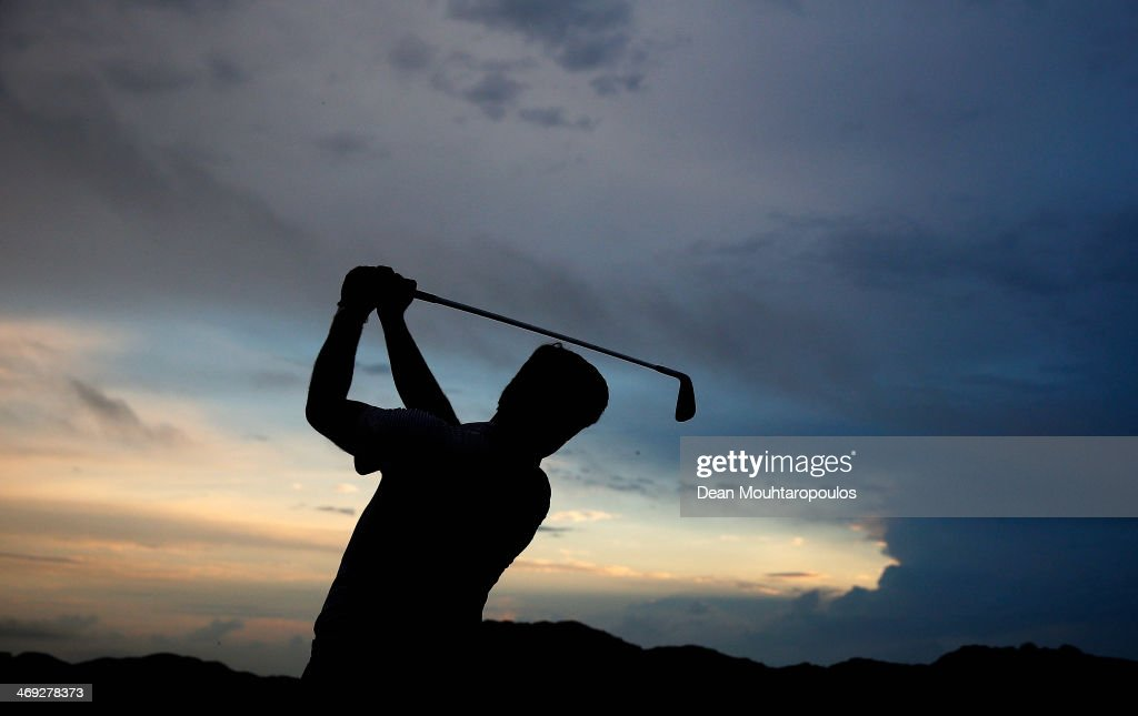 Robert Rock of England hits a practice shot on the driving range prior to Day 2 of the Africa Open at East London Golf Club on February 14, 2014 in East London, South Africa.
