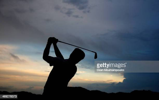 Robert Rock of England hits a practice shot on the driving range prior to Day 2 of the Africa Open at East London Golf Club on February 14 2014 in...