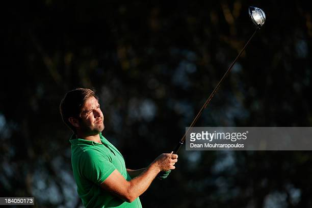 Robert Rock of England hits his tee shot on the 12th hole during the second round of the Portugal Masters at Oceanico Victoria Golf Course on October...