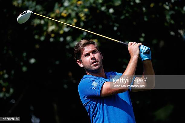 Robert Rock of England hits his tee shot on the 18th hole during Day Two of the Joburg Open at Royal Johannesburg and Kensington Golf Club on...