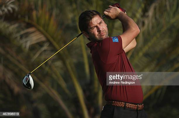 Robert Rock of England hits his teeshot on the 14th hole during the first round of the Abu Dhabi HSBC Golf Championship at the Abu Dhabi Golf Cub on...