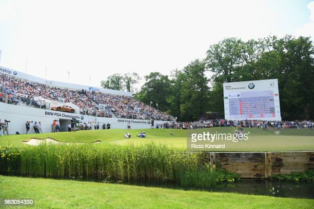 Robert Rock of England lines up a putt on the 18th green during the final round of the BMW PGA Championship at Wentworth on May 27 2018 in Virginia...