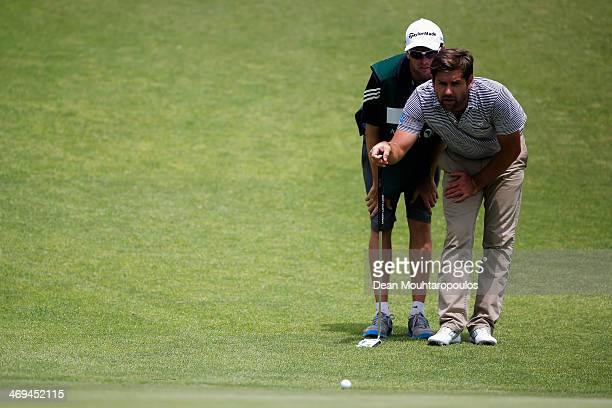 Robert Rock of England lines up a putt on the 5th green during Day 2 of the Africa Open at East London Golf Club on February 14 2014 in East London...