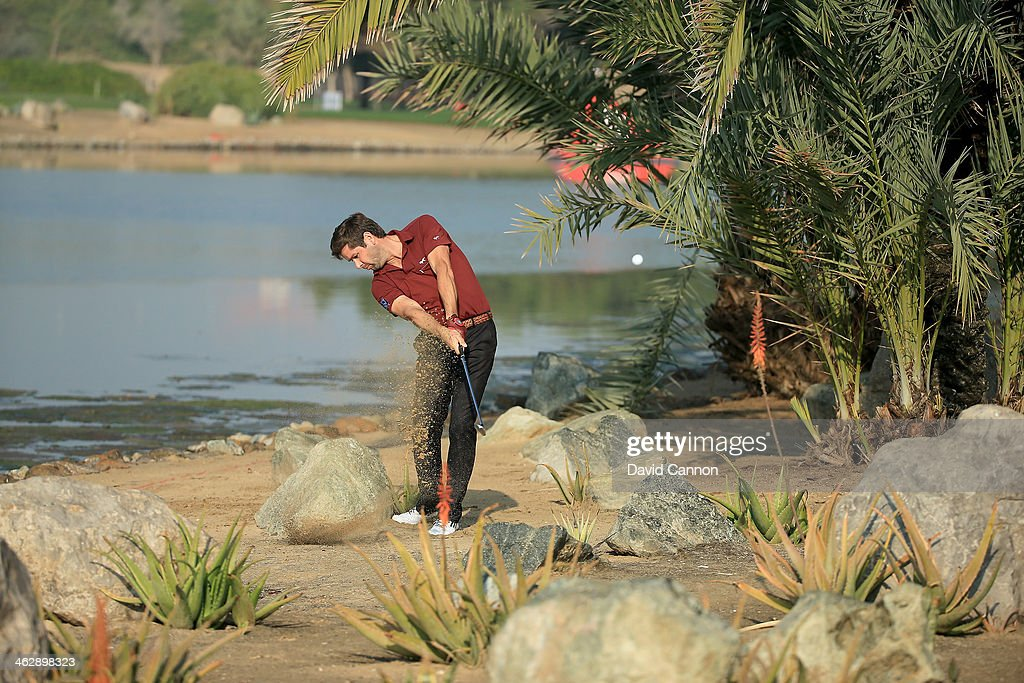 Robert Rock of England plays his second shot at the par 4, 14th hole during the first round of the 2014 Abu Dhabi HSBC Golf Championship at Abu Dhabi Golf Club on January 16, 2014 in Abu Dhabi, United Arab Emirates.