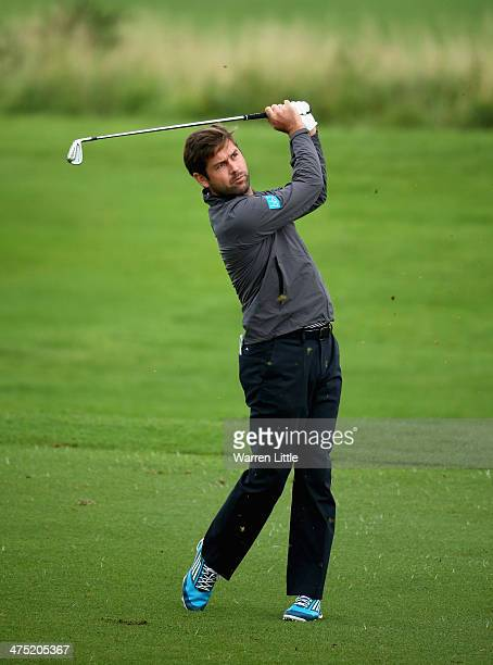 Robert Rock of England plays his second shot into the 10th green during the first round of the Tshwane Open at Copperleaf Golf Country Estate on...