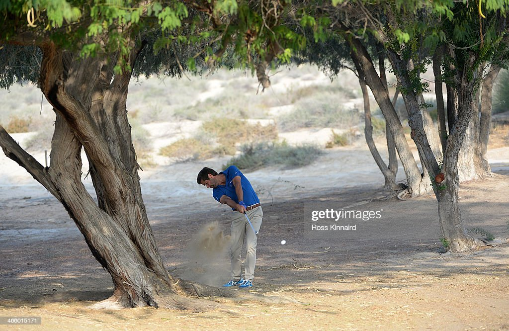 Robert Rock of England plays his second shot on the par five 3rd hole during the second round of the Omega Dubai Desert Classic on the Majlis Course at the Emirates Golf Club on January 31, 2014 in Dubai, United Arab Emirates.