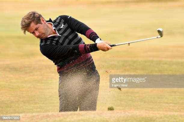 Robert Rock of England plays out of the rough on hole eighteen during day one of the Aberdeen Standard Investments Scottish Open at Gullane Golf...