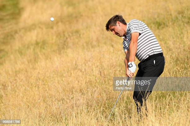 Robert Rock of England plays out of the rough on hole one during day three of the Aberdeen Standard Investments Scottish Open at Gullane Golf Course...