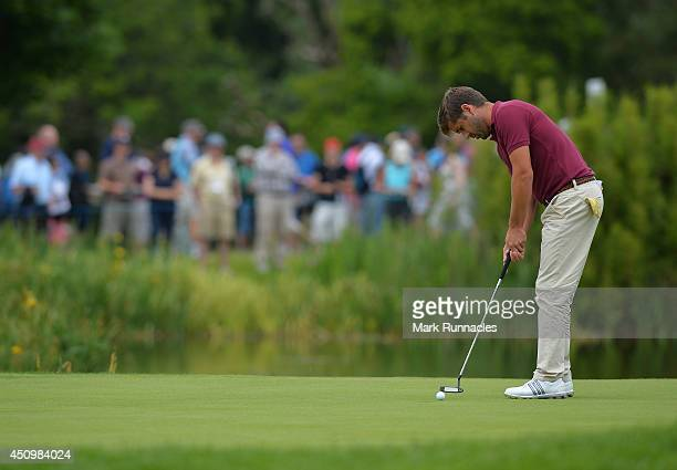 Robert Rock of England putting on the 8th green during the third round of the Irish Open at Fota Island resort on June 21 2014 in Cork Ireland