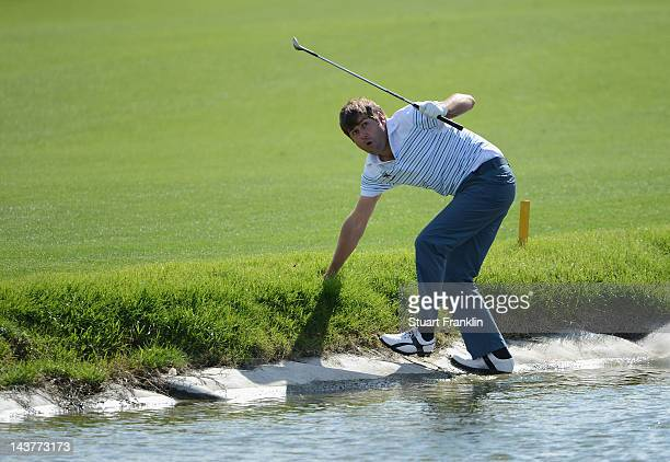 Robert Rock of England reacts after playing a shot on the 14th hole during the first round of the Open de Espana at Real Club de Golf de Sevilla on...