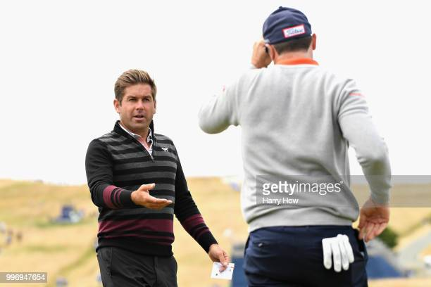 Robert Rock of England shakes hands with Julien Guerrier of France on hole eighteen during day one of the Aberdeen Standard Investments Scottish Open...