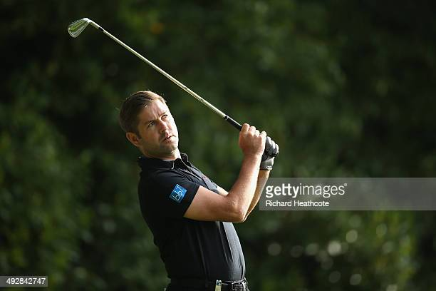 Robert Rock of England tees off on the 2nd hole during day one of the BMW PGA Championship at Wentworth on May 22 2014 in Virginia Water England