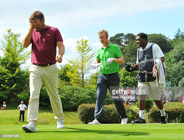 Robert Rock of England walks from the 18th green followed by Mikka Ilonen of Finland during the third round of the Irish Open at Fota Island resort...