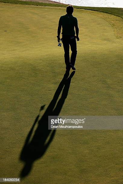 Robert Rock of England walks on the 11th green during the second round of the Portugal Masters at Oceanico Victoria Golf Course on October 11 2013 in...