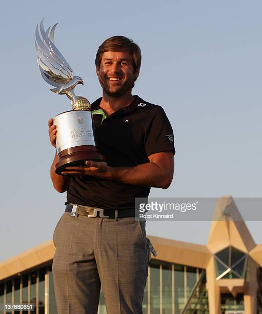 Robert Rock of England with the Champions trophy after winning the Abu Dhabi HSBC Golf Championship at the Abu Dhabi HSBC Golf Championship on...
