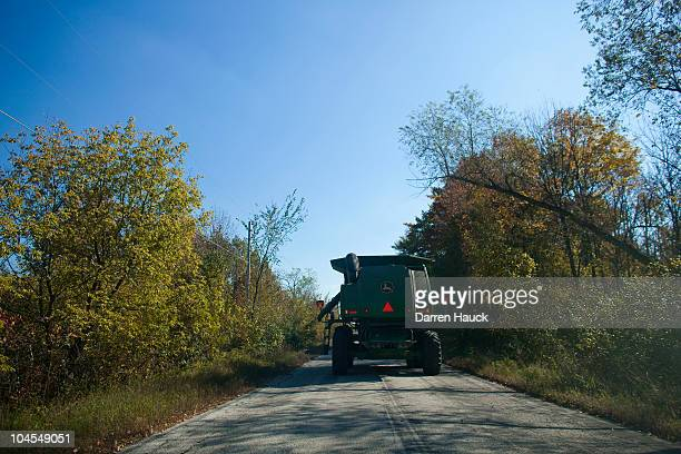 Robert Roden drives a tractor to a soy bean field on the RobNCin farm on September 29 2010 in West Bend Wisconsin The farm has roughly 400 head of...