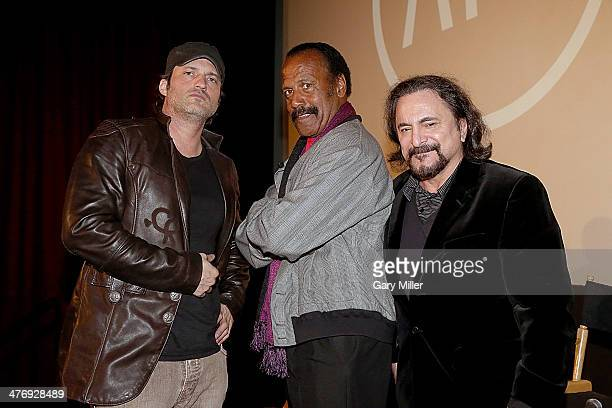 Robert Rodriguez Fred The Hammer Williamson and Tom Savini pose onstage after a screening of From Dusk Till Dawn at the Marchesa Theater on March 5...