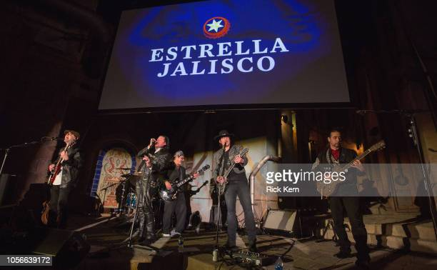 Robert Rodriguez performs with his band Chingon at Estrella Jalisco's Day of the Dead celebration at Rodriguez's Troublemaker Studios on November 2...