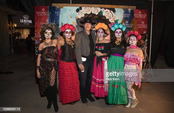 Robert Rodriguez poses with Catrinas at Estrella Jalisco's Day of the Dead celebration at Rodriguez's Troublemaker Studios on November 2 2018 in...