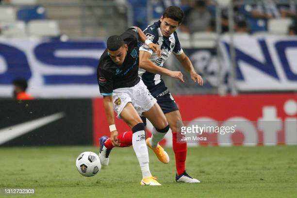 Robert Rosado of Atletico Pantoja fights for the ball with Eric Cantu of Monterrey during a second leg match between Monterrey and Atletico Pantoja...